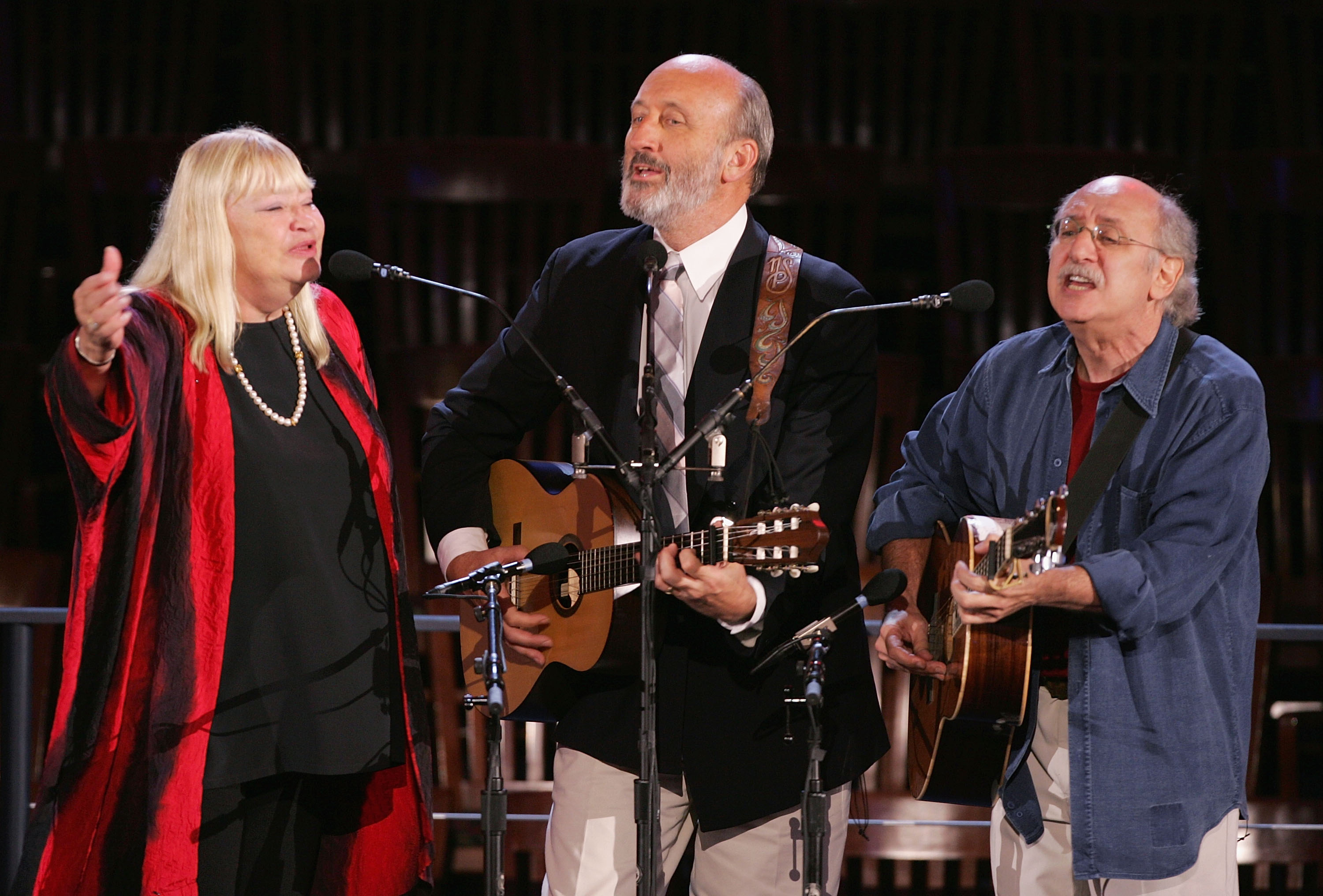 "BOSTON - JULY 27:  Sixties folk music group Peter, Paul and Mary perform the Bob Dylan song ""Blowing in the Wind"" at the Democratic Convention July 27, 2004 in Boston, Massachusetts.  (Photo by Mark Wilson/Getty Images)"
